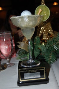 Closeup of the prized Far Out Award at the Christmas Party after the winner was revealed.