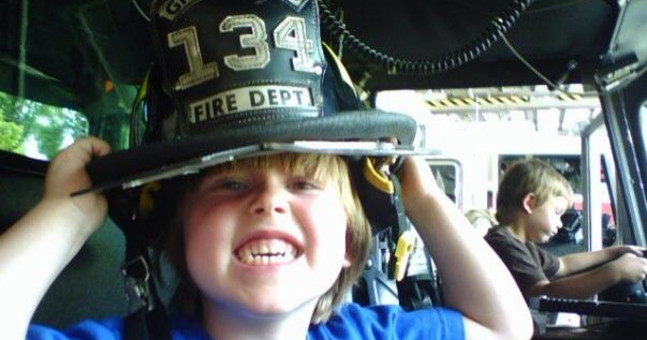 Zane rocking a champion smile and firefighter hat