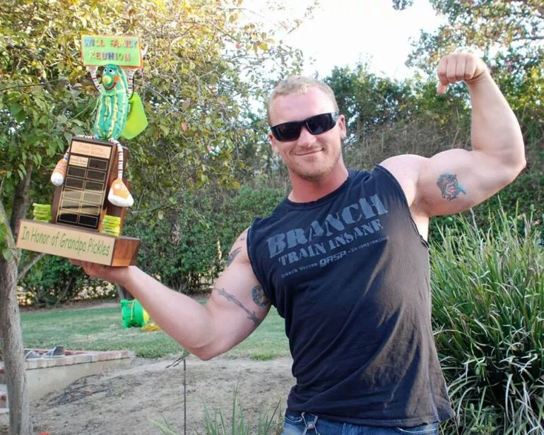 Brandon, the winner of the pickle eating contest, with the Super Pickle Trophy